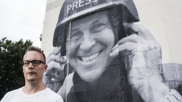 Free speech: Street artist Hego in front of his Peter Greste mural.