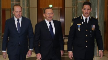 Prime Minister Tony Abbott attended the swearing in ceremony of the inaugural Border Force Commissioner Roman Quaedvlieg with Immigration minister Peter Dutton at Parliament House.
