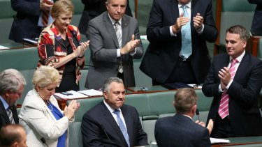 Joe Hockey is applauded by colleagues after his speech.