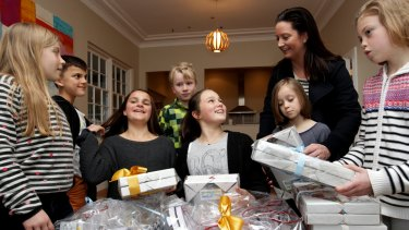 Building bonds: Kylie Macdonald and children involved in Kids in Philanthropy with the prizes for their fund-raising gala.