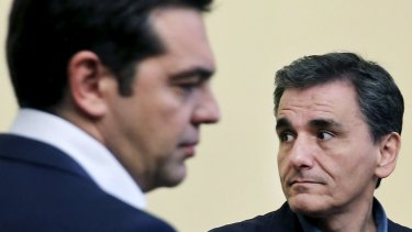 Tsakalotos looks on during his swearing in ceremony with Greek Prime Minister Alexis Tsipras.