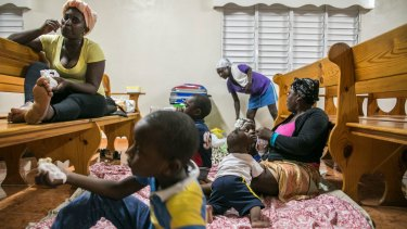 Families gather at a shelter in a local church on the eve of the arrival of Hurricane Irma in Las Terrenas, Dominican Republic.