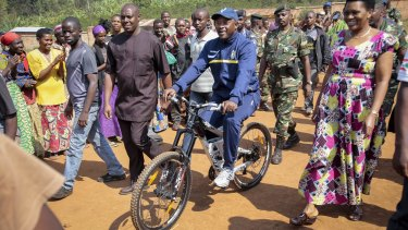 President Pierre Nkurunziza rides a bicycle to cast his vote in the presidential election, which he won, in July last year. Violence has flared since he earlier announced  his intention to stand for a third term.