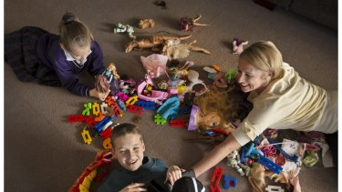 Andrea Faragher and her children Jake and Alysha play with their toys. Ms Faragher believes their toys are lacking in diversity.