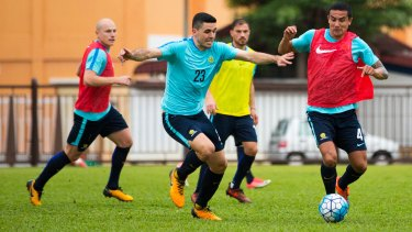 Key men: Tom Rogic and Tim Cahill will have big roles to play against Syria on Tuesday night.