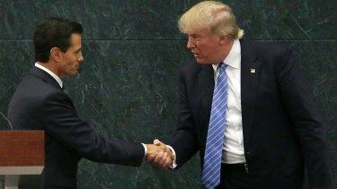 Mexican President Enrique Pena Nieto and Republican presidential nominee Donald Trump shake hands.