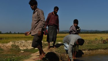Four Rohingya men flee the violence in Myanmar by crossing to Bangladesh in November.