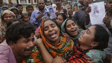 Relatives of Mohammed Abdullah, garment worker in Rana Plaza, cry as they as they arrive to collect his body near Dhaka, Bangladesh.