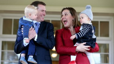 Christian Porter, with his son Lachlan, and Kelly O'Dwyer, with her daughter Olivia, at the ministerial swearing ceremony in July 2016.
