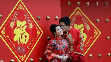 A young Beijing couple have a formal wedding portrait taken this month.