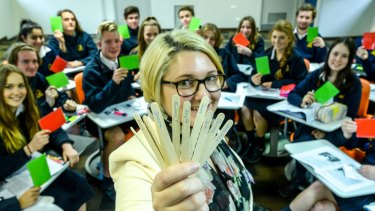 Frankston High School teacher Sarah Lefebure with ice-cream sticks that have the year 11 English students' names on them.