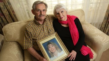 John and Helen Magill with a picture of their daughter Jane Thurgood-Dove. A suspected go-between in her murder contract is alive and a reward is on offer.