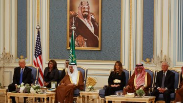 US President Donald Trump listens during the presentation ceremony for the Collar of Abdulaziz. A portrait of King Abdulaziz hangs on the wall above his son, King Salman, his grandson, Prince Mohammed bin Nayef, and US Secretary of State Rex Tillerson.