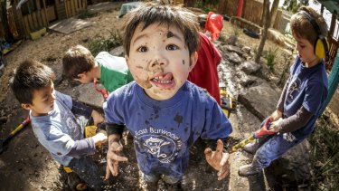Kinder kids playing in the mud play area at East Burwood Preschool.