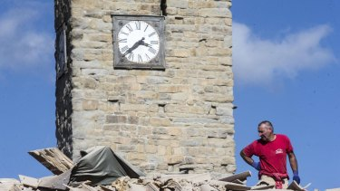 The clock of the Bell Tower of the Italian village of Amatrice is stopped at the time when an earthquake struck central Italy.