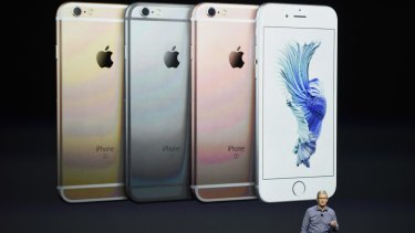 Apple chief executive Tim Cook unveils the iPhone 6s, in four colours.