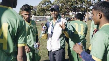Mohammed Younus addresses the team.