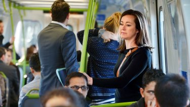 Forced to stand: Claire Denby makes her way from West Footscray to North Melbourne by train.