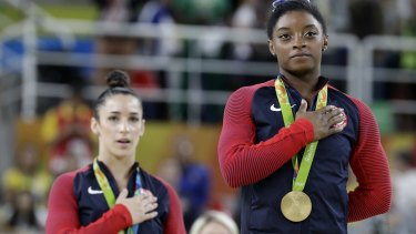 American Olympic medallists Simone Biles (right) and Aly Raisman heard their anthem again and again in Rio.