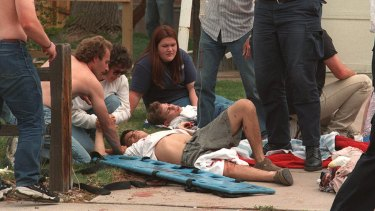 Rescuers tend to the wounded at a triage area near Columbine High School during a shooting rampage by Eric Harris and Dylan Klebold.