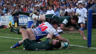 Glory days: John Grant crosses in the corner as Eastwood hammer Randwick at TG Millner Field in the preliminary final in 2011.