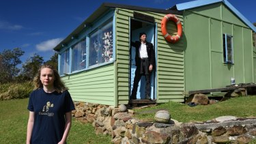 Artist Reg Mombassa with his daughter and artist Lucy O'Doherty in a shack at Little Garie, in the Royal National Park.