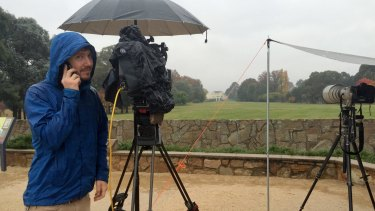 A wet and cold channel 9 cameraman wishes his mother Happy Mother's day while staking out Government House ahead of the expected arrival of Prime Minister Malcolm Turnbull.