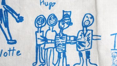 Hugo Atkinson's family drawing on his Year 1 tea towel.