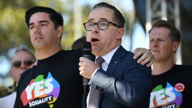 "Alan Joyce and his partner celebrate the ""yes"" campaign's win at a picnic in Sydney on Wednesday."