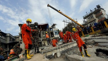 India's National Disaster Response Force personnel search for the victims.