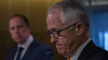 Malcolm Turnbull and Immigration Minister Peter Dutton announce the move to permanently ban the entry of asylum seekers and refugees who arrive by boat.