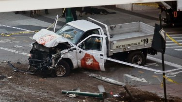 The damaged Home Depot truck came to rest in the bike lane in New York City.