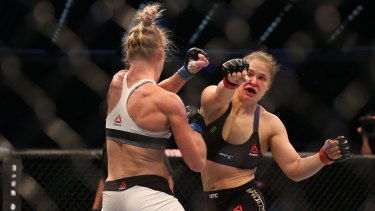 Ronda Rousey and Holly Holm  compete in their UFC women's bantamweight championship bout.