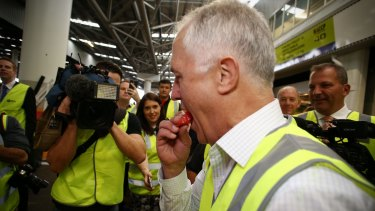 The Prime Minister tries some watermelon.