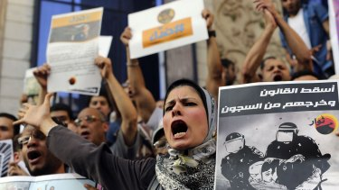 Activists in Cairo reject the Egyptian government's anti-protest laws in May.