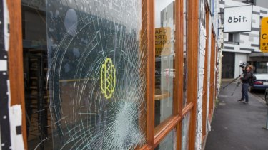 Sixteen window panels were smashed at 8-Bit over the New Year's Eve weekend. The burger restaurant has been targeted again a week later.
