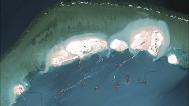 A satellite image shows Chinese dredges working at the northernmost reclamation site of Mischief Reef, part of the Spratly Islands, in the South China Sea, in March.