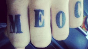 Knuckles tattooed with MEOC, which stands for Middle Eastern Organised Crime.