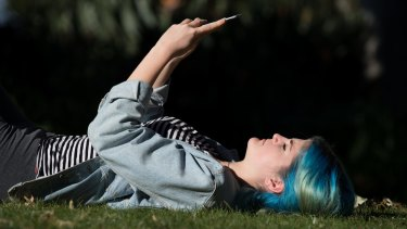 Isabella Merrilees-White takes a moment with an app on her smartphone at uni.