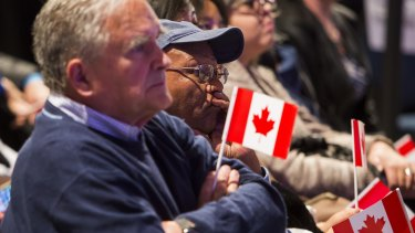 Supporters of Conservative Leader Stephen Harper watch the polls as broadcasters project a Liberal Party victory on election day in Calgary, Alberta.