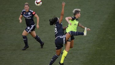 Samantha Johnson of Melbourne Victory and Michelle Heyman of Canberra United collide.