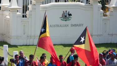 The protesters assembled outside the gates of the Australian embassy in Dili.