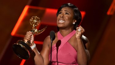 Actress Uzo Aduba accepts an Outstanding Supporting Actress Emmy for her role in Orange is the New Black.