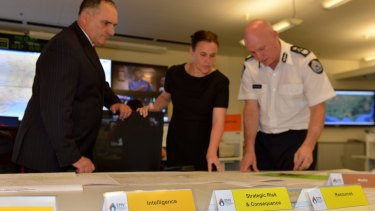 Joe Buffone, with the then emergency services minister, Jane Garrett, and Emergency Management Commissioner Craig Lapsley at the state control centre in October last year.