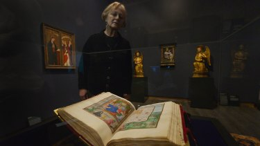 Erica Persak with the  Rothschild Prayerbook. Bought at auction for $15.5 million by Kerry Stokes, it's now on display at the Ian Potter Museum.