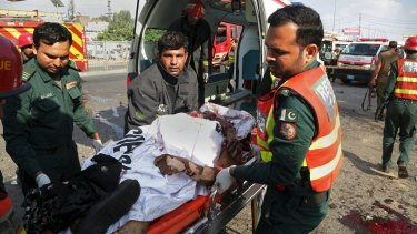 Pakistani rescue workers remove a body from the site of the deadly bombing.