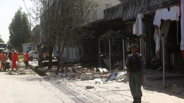 Municipality workers clean up at the site of Monday's suicide attack in Kabul.