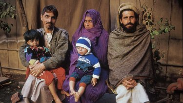 Sharbat Gula with her family in 2002.
