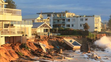 The yards of houses on Collaroy Beach, including a swimming pool, were eroded by the storm.