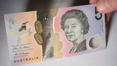 Some machines are spitting out the new $5 note.